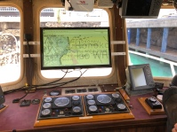 An admiral chart of the survey region displayed over the captain's screen, as Breden adds survey tracks to the HyPack navigation software.