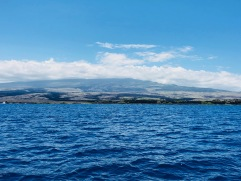 The view of the Hualalai​ volcano from the Huki Pono survey boat.