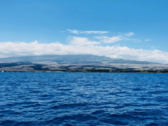 The view of the Hualalai volcano from the Huki Pono survey boat.